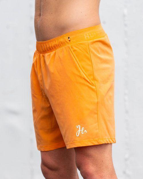 Padel shorts i en ljus orange - Stryker Humbleton